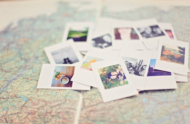 Mobile Website: Where Words Fail, An Image Speaks image of many photos on a large map.