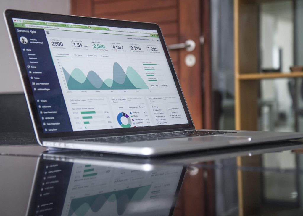 Lead Generation Strategies: An image of a Laptop placed on the table.